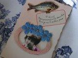 アンティークポストカード「Poisson d'Avril」 青い花と女性